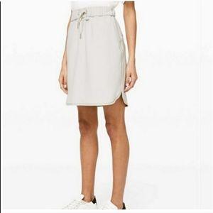 Lululemon on the fly light cream colored skirt